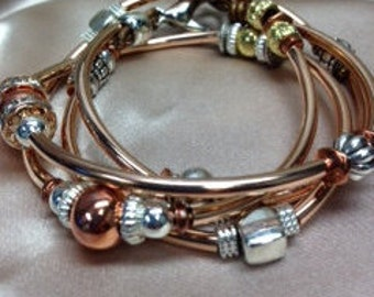 Rose Gold tube and mixed metals wrap bracelet