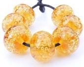 Handmade lampwork bead set of 7 orange glass bubble beads