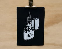 Cosmic Zippo Patch screen printed black canvas