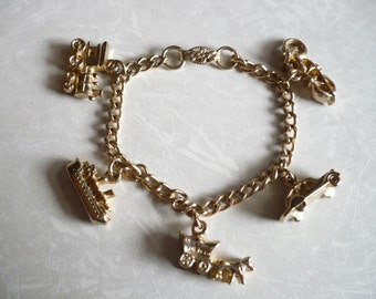 Vintage Child's Charm Bracelet Transportation Theme Car Ship Train Motorcycle Wagon Gold Tone Metal 5 3/4""""