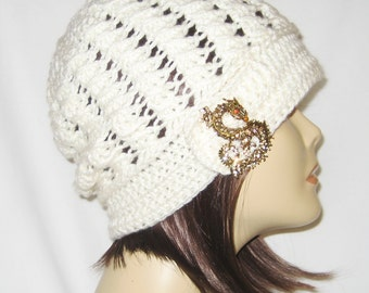 """Slouch decorated with brooch,beanie,hat,cap,color ivory,made to fit most teens & adults 21-23"""""""