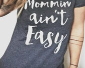 FREE SHIPPING- Mommin' Ain't Easy , Choose Your Size, Style & Color (Put size in message to seller section)
