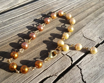 Beautiful cream to bronze ombre pearl bracelet