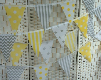 "Banner, bunting. 5""x 7"" flags. Grey (gray), yellow & white.  Stars, chevrons, spots, stripes. Single-sided flags. Per metre (39"")."
