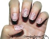 Estelle's doodle nail wraps. Adorable pink nail polish strips.
