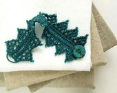 Knitting lace wrist cuff bracelet with seed beads and button dark blue-green color