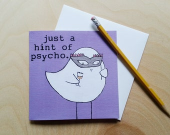 "CARD: ""Just a Hint of Psycho"" featuring a bird with a carnival mask and a glass of wine"
