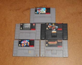 Lot of 5 SNES Super Nintendo Games KILLER INSTINCT, Tetris 2, Pac-Man 2, RoboCop vs Terminator, and Mario Paint.