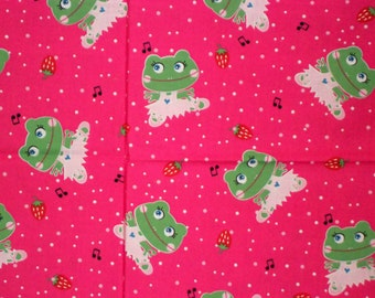 One yard of cotton fabric with lady frogs with pink background and musicial notes and strawberrys