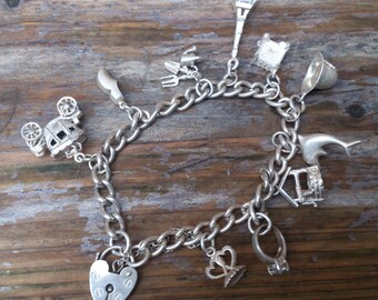 vintage sterling silver charm bracelet with 10 charms
