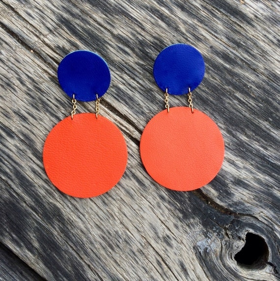 Electric blue and tangerine orange statement circle leather earrings