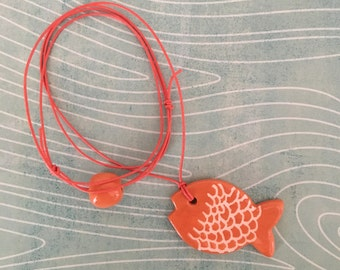 Lanyard pendant necklace with red and white ceramic shaped sienna brown fish