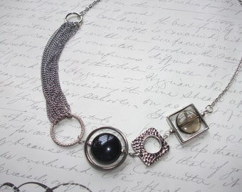 Modern necklace with geometric elements