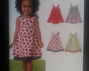 New Look 6974 Toddlers Summer Dress / Sundress 4 Styles sewing pattern sizes 1/2-1-2-3-4