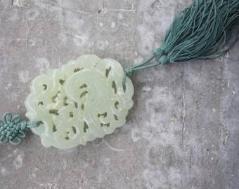 Pale Green Carved Jade Pendant with Bird