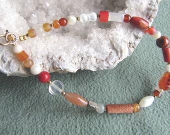 Bracelet multi-gemstone goldstone, carnelian, sponge coral, orange adventurine, red jasper, mother pearl, 12k goldfilled beads, clasp 8 inch