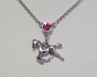 Horse necklace with pink Swarovski crytal. Rhodium plated chain CCS117