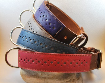 Rouxie leather dog collar, 100% leather, with stitching and a decorative leather stripe and reflective material.