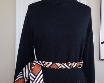 Vintage Chainlink Belt Wrapped around an Abstract Black, Brown and White Scarf