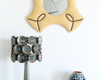 Vintage mirror, cream color leatherette and brass tacks. Mid century 60s.