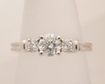 1.00 Carat T.W. Ladies Round Cut Diamond Engagement Ring Platinum