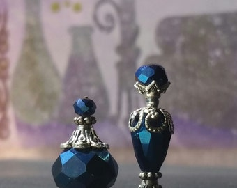 Miniature blue crystal glass perfume or potion bottle