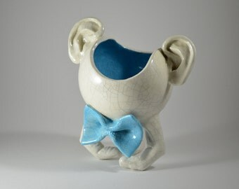 Flowerpots head with bow tie