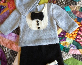 Cute black tie baby suit. Pants, top, hat and bootees in grey black and white with black tie and button feature