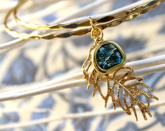 EGLE-Bangle with Blue Crystal and feather charm