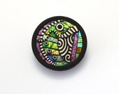 Pin brooch pendant necklace Round circle polymer clay iridescent green purple colors  black and white elements