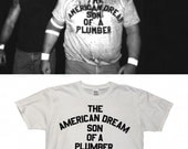 the AMERICAN DREAM son of a plumber | dusty rhodes inspired t shirt, WWE, pro wrestling, sturgis, vintage style, 70s iron letters, plus size