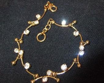 Elegant Rhinestone and Gold Finish Metal Bracelet