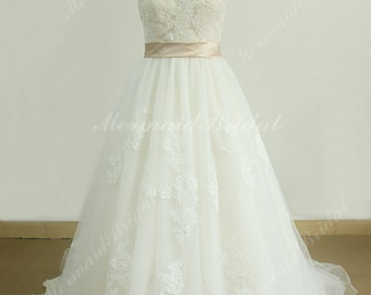 Romantic ivory a line lace wedding dress with blush lining and illusion neckline