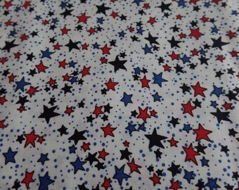 red, blue, and dark blue stars with a white background