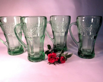 Vintage Coca Cola Coke  Set of 4  Green Glass Mugs with Handles.  The Mugs hold 14 oz and are great for entertaining!