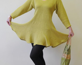 Mustard yellow linen tunic dress with three-quarter length sleeves and scalloped hem.