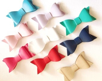 Faux leather bows on Headband or hair clip.