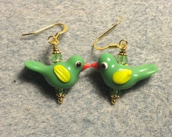 Bright green lampwork songbird bead earrings adorned with green Chinese crystal beads.