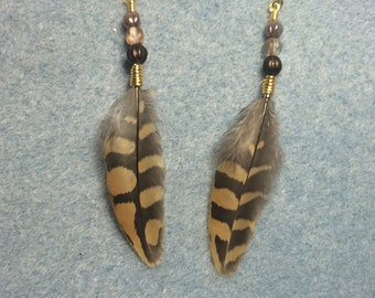 Brown striped partridge feather earrings adorned with brown Czech glass beads.