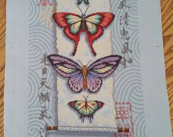 Butterflies on oriental scroll. Unframed finished cross stitch kit from dimensions.