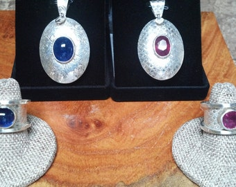 Niceee .... Natural Rubies and Sapphires mounted in .999 pure Silver.