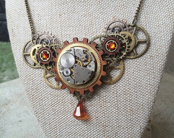 Steampunk brass, beautiful Australian wood, watch mechanisim  and Swarovski crystal statement necklace. Alchemy alice