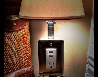 Lamp with 1 receptical and 2 USB ports.
