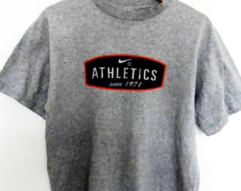 Vintage Nike t shirt athletics since 1971 Made in USA Medium Size Heather Gray