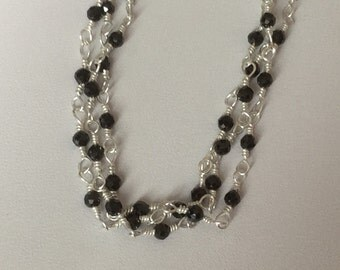 Three strabded bracelet usibg 925 sterling silver and black spinel.