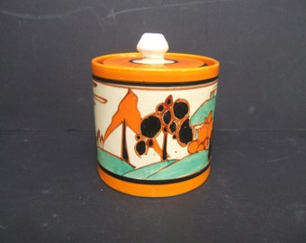 Clarice Cliff Art Deco Trees and House Preserve pot and lid.