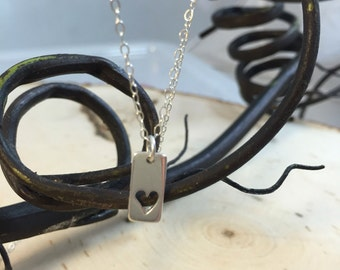Sterling silver charm necklace.