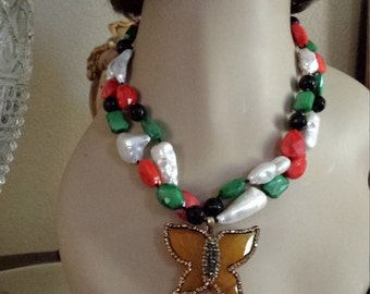 Two strand beaded faceted necklace made with faceted black onyx, art glass and fresh water pearls and jasper butterfly drop