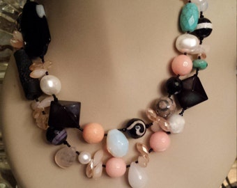 Two strand beaded necklace made with assorted faceted semi precious stones