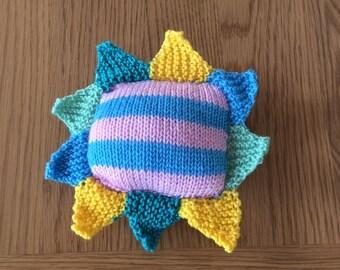 Handknitted multicoloured pin cushion